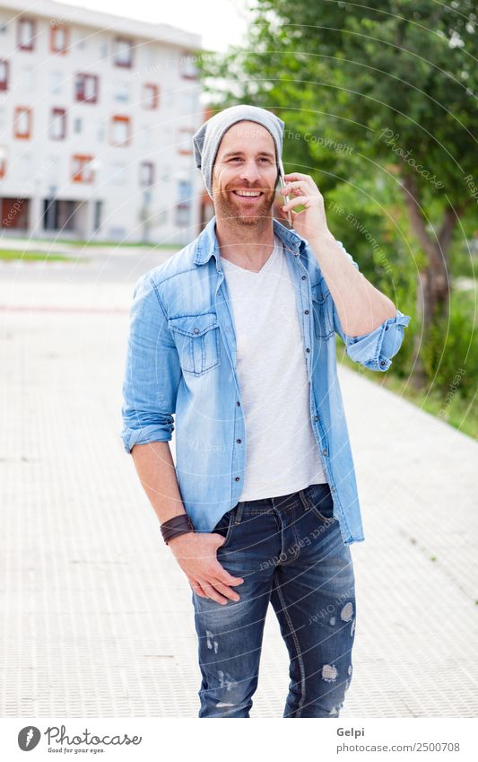 Casual guy Lifestyle Style Joy Happy Leisure and hobbies To talk Telephone PDA Technology Human being Man Adults Street Fashion Shirt Hat Beard Listening