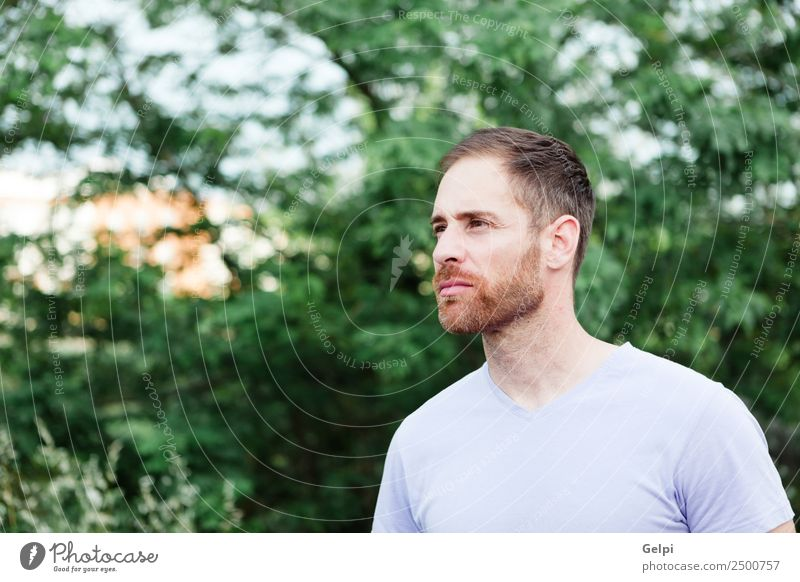 Portrait of a casual bearded man Lifestyle Style Happy Hair and hairstyles Face Relaxation Human being Masculine Boy (child) Man Adults Nature Park Fashion