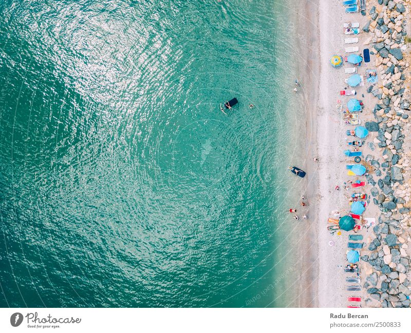 Aerial View From Flying Drone Of People Crowd Relaxing On Beach In Romania At The Black Sea Aircraft Vantage point Sand Background picture Water Above Ocean