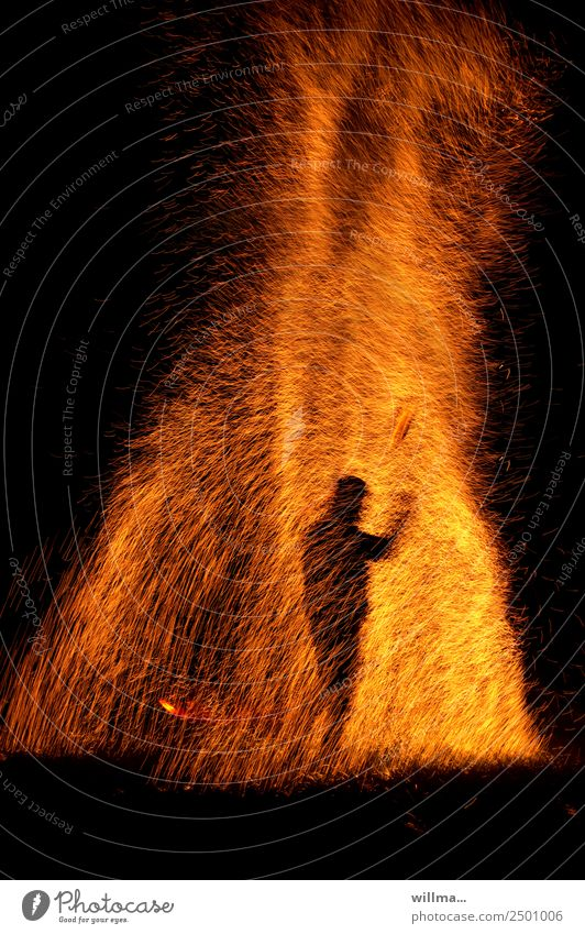 Man stands in a shower of sparks Fire Human being Silhouette Hot Threat Spark Burn Blaze Flame Dangerous Arson Copy Space bottom Night Elements