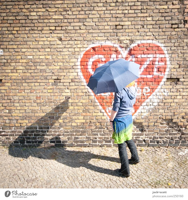 Old love never dies. Joy Happy Senses Woman Adults 1 Human being 45 - 60 years Kreuzberg Old town Brick wall Skirt Pants Sweater Graffiti Heart Line To hold on