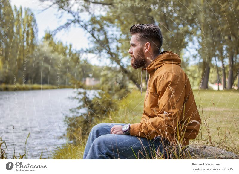 Man sitting by the river in fall Lifestyle Human being Masculine Young man Youth (Young adults) Body 1 18 - 30 years Adults Nature Landscape Water Autumn Tree