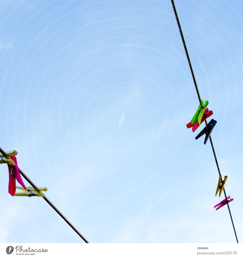 clothesline Sky Cloudless sky Multicoloured Rope Laundry Clothesline Clothes peg Row Plastic Dry Colour photo Exterior shot Deserted Copy Space left