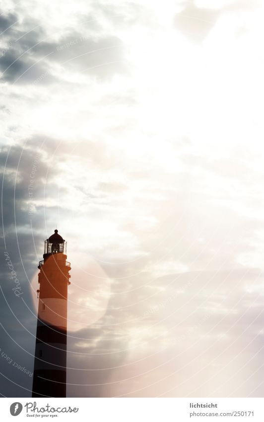 light view Vacation & Travel Ocean Island Landscape Sky Clouds Sun Beautiful weather Coast North Sea Lighthouse Bright Amrum Lens flare Beacon Illuminate