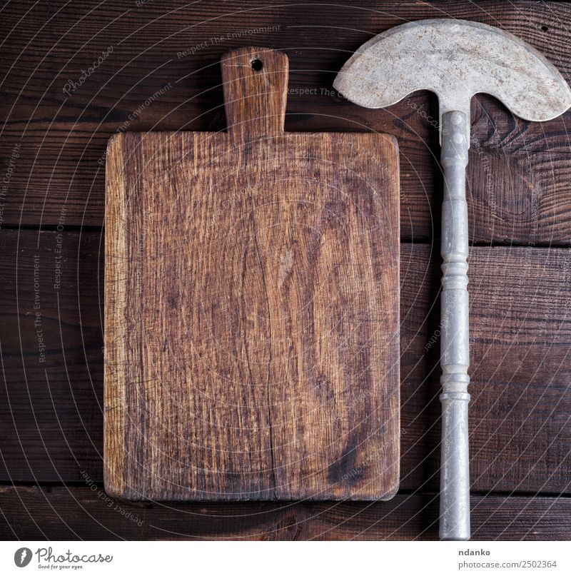 hatchet for cutting meat or vegetables Knives Kitchen Work and employment Tool Wood Metal Steel Rust Old Dirty Retro Brown knife rounded Chopping board Towel