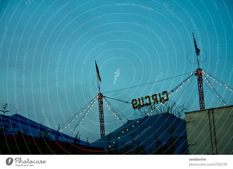 circus Leisure and hobbies Playing Entertainment Event Fairs & Carnivals Art Circus Shows Good Dusk Sky Clue Orientation Arrow Poster Direction sign urban