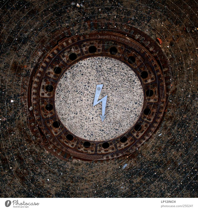 Electric Gulli Sand Concrete Sign Arrow Attentive Electricity Gully Round Floor covering Public utilities lightning bolt Colour photo Exterior shot Deserted Day