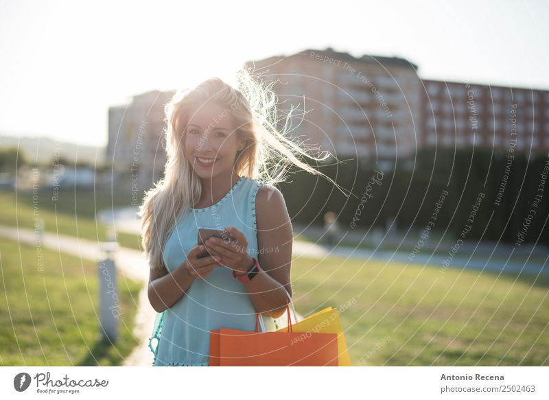 Beauty woman looking smartphone Woman Human being Youth (Young adults) Young man 18 - 30 years Adults Park Blonde Technology Smiling Shopping Telephone Internet