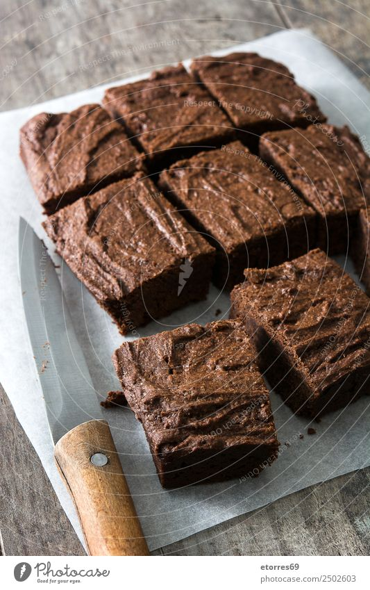 Chocolate brownie portions on wood Food Cake Dessert Candy Nutrition Organic produce Vegetarian diet Knives Wood Brown Baked goods Sweet Food photograph Snack