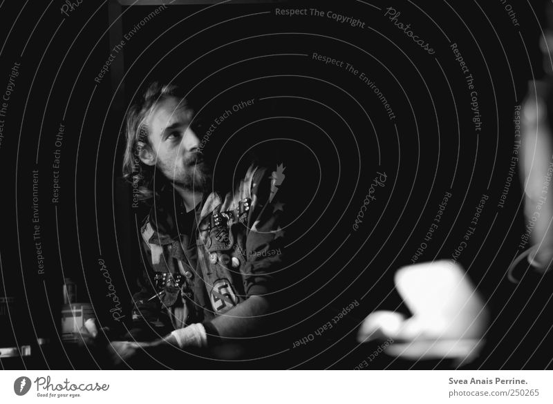 Human being Loneliness Sadness Blonde Masculine Exceptional Uniqueness Meditative Jacket Curl Long-haired Punk Stud Portrait photograph Black & white photo