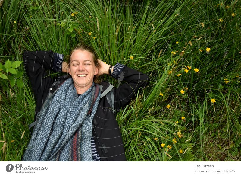 Laughing lying in the grass, eyes closed. Vacation & Travel Tourism Woman Adults 1 Human being 18 - 30 years Youth (Young adults) Nature Flower Grass Meadow