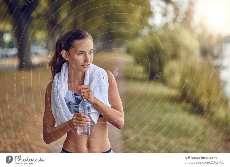 Fit sporty woman holding a bottle of water Bottle Sports Woman Adults 1 Human being 18 - 30 years Youth (Young adults) Park Fitness Running Athletic training