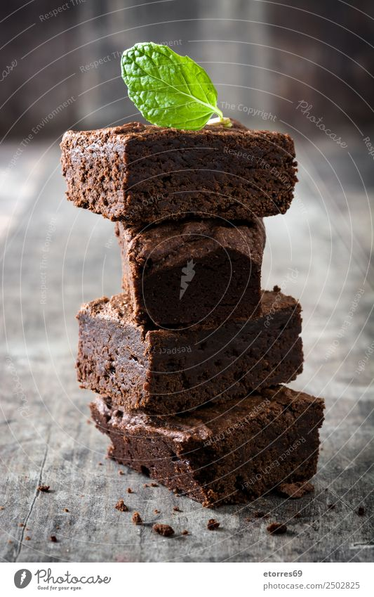 Chocolate brownie pieces on wood Brown Confectionary Sweet Candy Dessert Baked goods Cake nut walnuts Food Healthy Eating Food photograph Snack Delicious Baking
