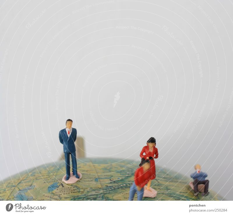 Four people (figures) on a globe. Population. Citizen of the world Human being Masculine 4 Clothing Workwear Tie Crouch Figure Model-making Globe Earth Stand