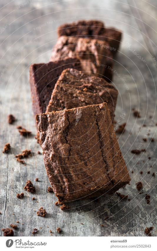Chocolate brownie pieces on wooden background Brown Confectionary Sweet Candy Dessert Baked goods Cake nut walnuts Food Healthy Eating Food photograph Snack