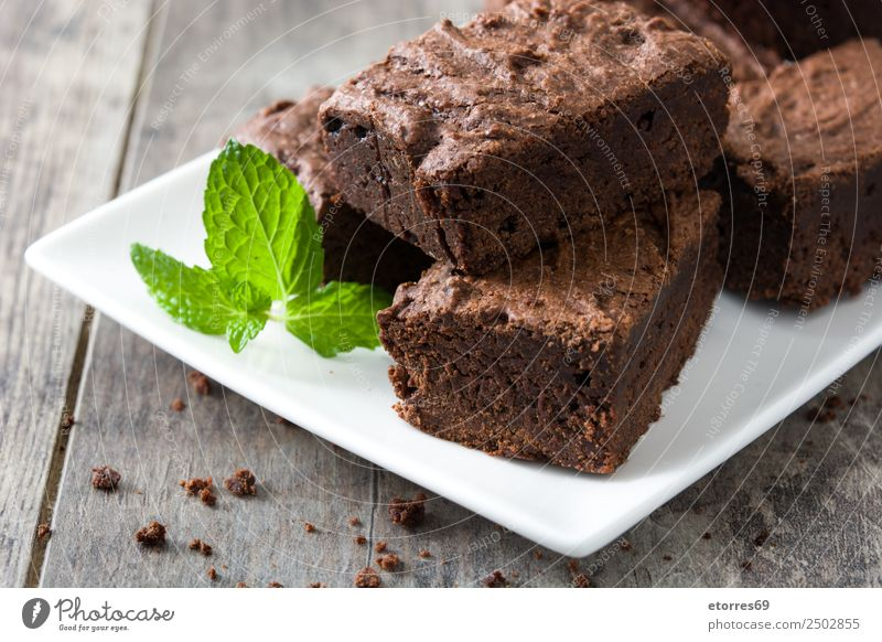 Chocolate brownie pieces on wood Brown Confectionary Sweet Candy Dessert Baked goods Cake nut walnuts Food Food photograph Snack Delicious Baking Tasty