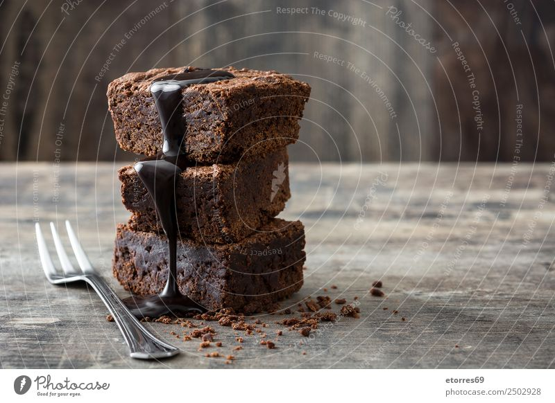 Chocolate brownie portions on wooden background Food Cake Dessert Candy Nutrition Breakfast Lunch Organic produce Vegetarian diet Fork Wood Metal Natural Brown