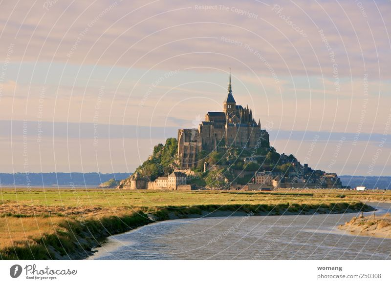 fairytale castle Mont St Michel France Europe Town Old town Church Castle Building Architecture Stone Water Lock Gigantic High tide Low tide Ocean