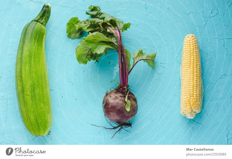 Beetroot, zucchini and corn on blue background Vegetable Nutrition Organic produce Vegetarian diet Table Kitchen Agricultural crop Fresh Natural Yellow Green