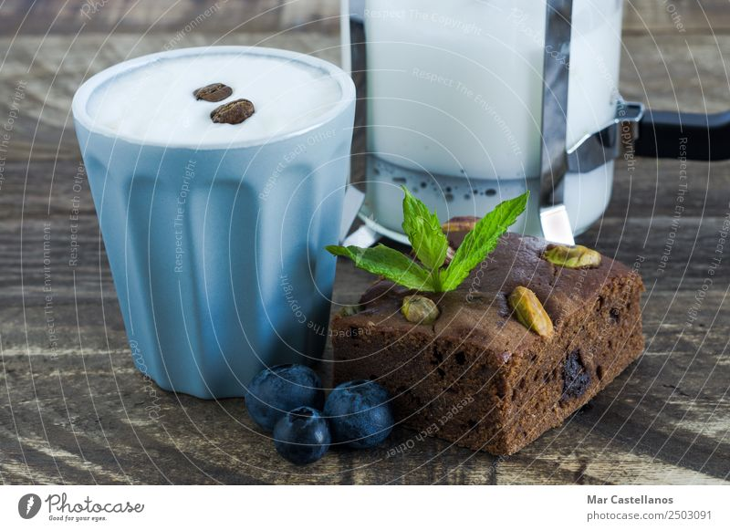 Brownie with fruits and glass of coffee Dessert Chocolate Eating To have a coffee Hot drink Coffee Mug Restaurant Going out Wood Feeding Write Fresh Delicious