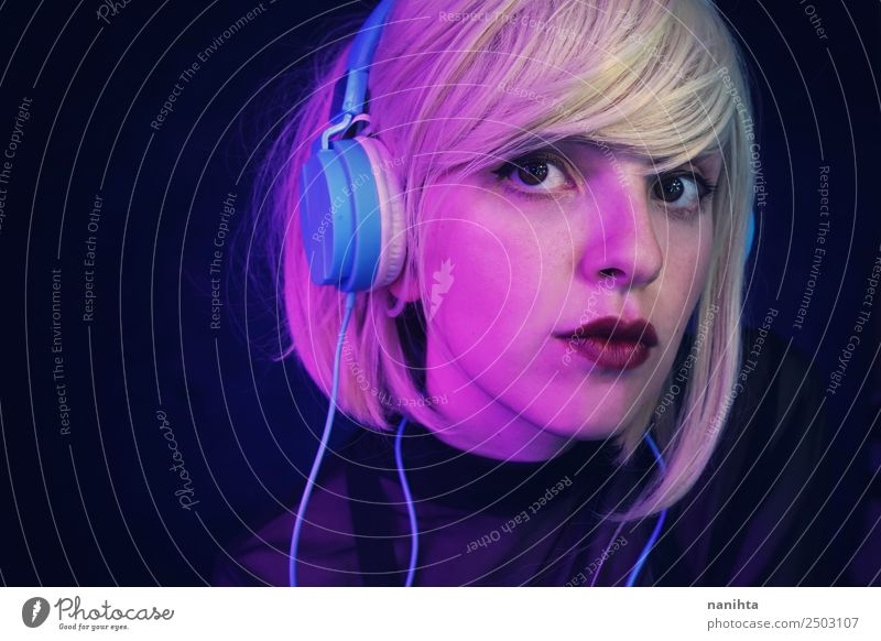 Portrait of a blonde young woman listening to music Lifestyle Style Design Beautiful Hair and hairstyles Face Leisure and hobbies Headset Headphones Technology