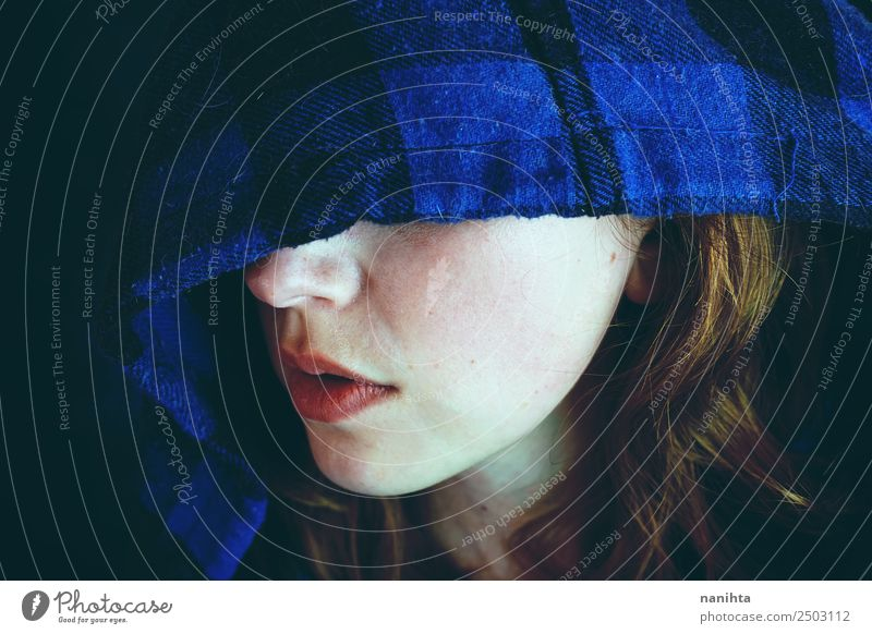 Mysterious young woman covering by a hood Human being Youth (Young adults) Young woman Blue Loneliness Dark 18 - 30 years Black Face Adults Sadness Feminine