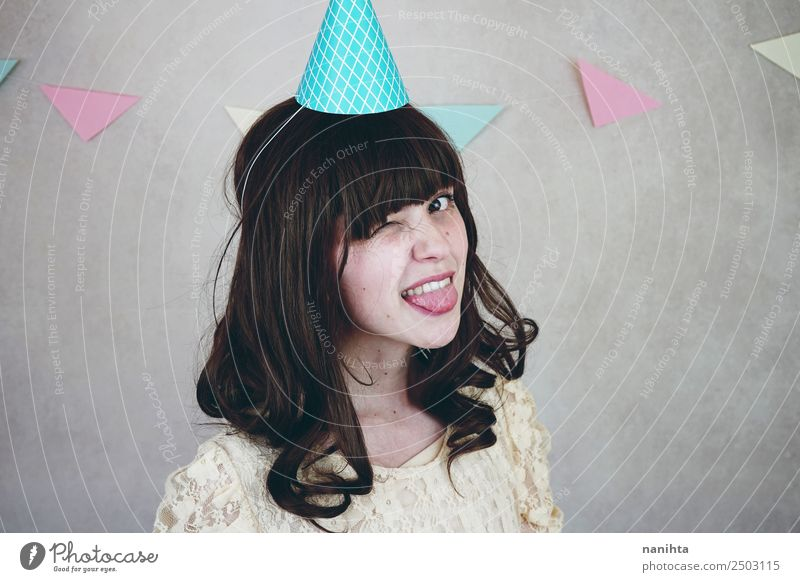 Young woman winking in a birthday party Style Face Wellness Well-being Contentment Feasts & Celebrations Birthday Human being Feminine Youth (Young adults) 1