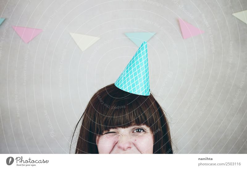 Young woman winking in a birthday party Human being Youth (Young adults) Joy 18 - 30 years Adults Lifestyle Funny Feminine Style Happy Party