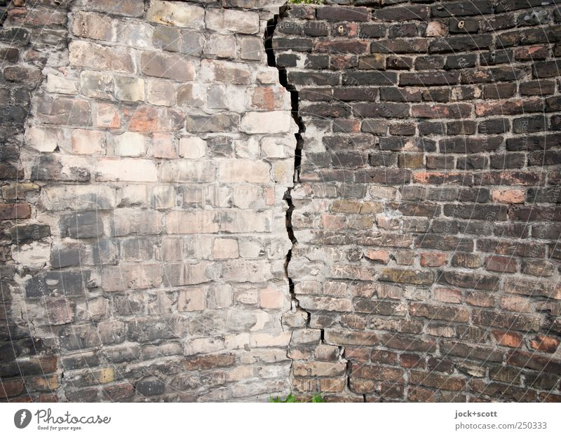 through-crack Old Wall (building) Wall (barrier) Line Dirty Gloomy Dangerous Threat Broken Sign Change Firm Anger Pain Brick Crack & Rip & Tear