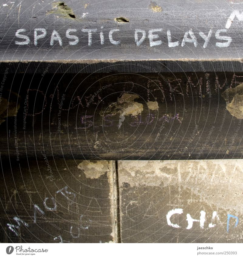 Spastic delays Wall (barrier) Wall (building) Stone Concrete Sign Characters Graffiti Rebellious Trashy Scribbles Daub Whimsical spastic Colour photo
