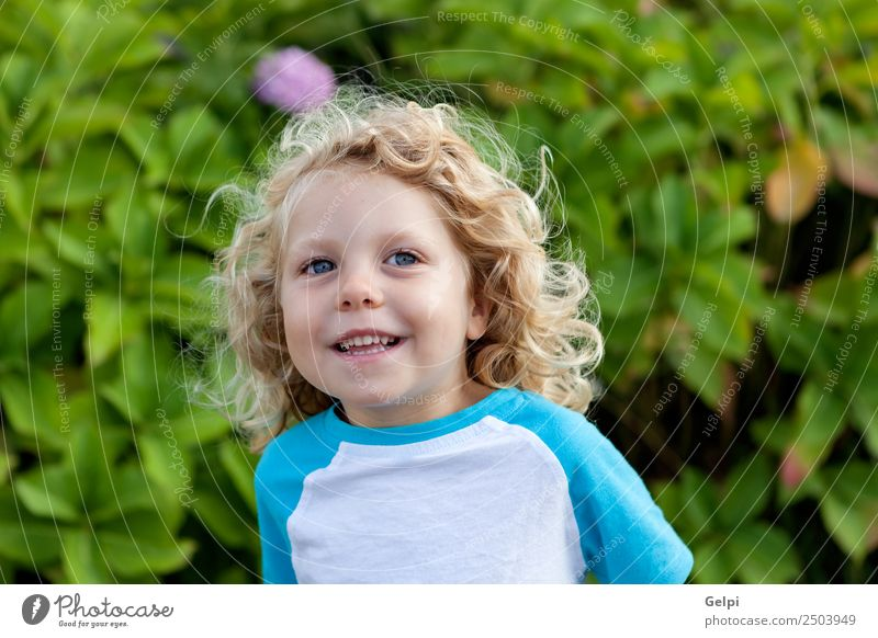 Small child with long blond hair Happy Beautiful Face Summer Child Human being Baby Boy (child) Man Adults Infancy Environment Nature Plant Blonde Smiling Sit