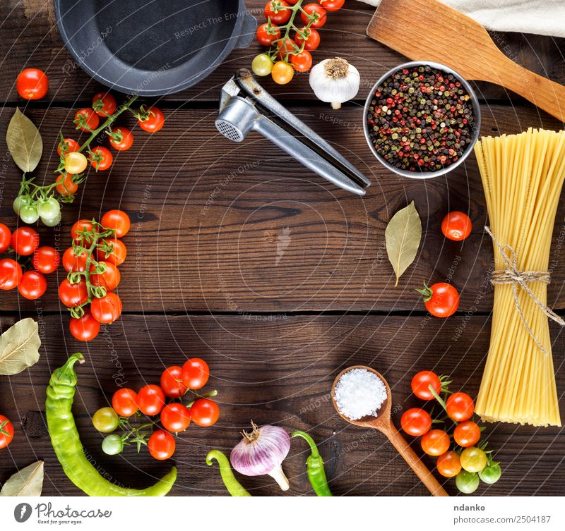 ingredients for cooking food Vegetable Dough Baked goods Herbs and spices Lunch Italian Food Pan Spoon Wood Eating Fresh Large Long Above Brown Yellow Red Black