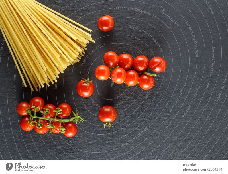 long pasta and ripe red cherry tomatoes Colour Red Black Eating Yellow Copy Space Above Fresh Large Vegetable Tradition Long Cooking Mature Baked goods Lunch