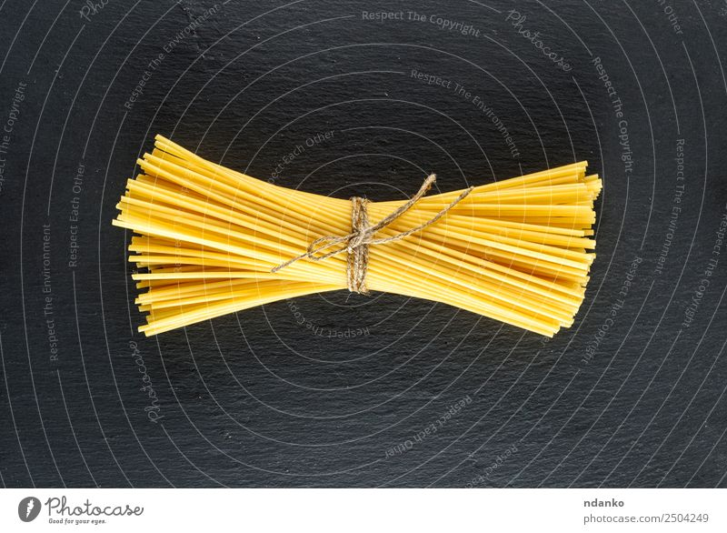 raw spaghetti Dough Baked goods Lunch Dinner Line Eating Fresh Large Long Above Yellow Black Colour Tradition Spaghetti pasta food background Raw Italian