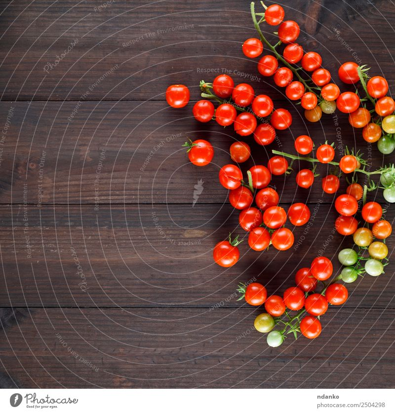 ripe red cherry tomatoes Vegetable Vegetarian diet Kitchen Wood Fresh Small Natural Above Brown Green Red Cherry Tomato food healthy Ingredients Organic Raw
