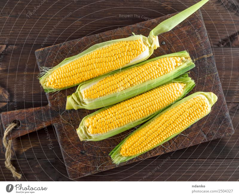 fresh ripe yellow corn cobs Vegetable Nutrition Vegetarian diet Table Nature Plant Leaf Wood Old Eating Fresh Natural Above Brown Yellow agriculture background