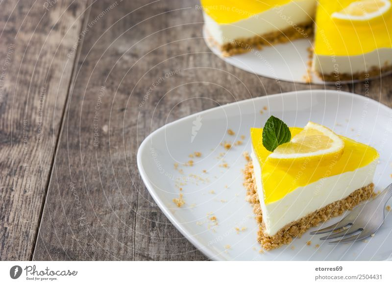 Lemon pie slice on wooden table Food Healthy Eating Food photograph Vegetable Fruit Baked goods Cake Dessert Candy Nutrition Vegetarian diet Yellow Green White
