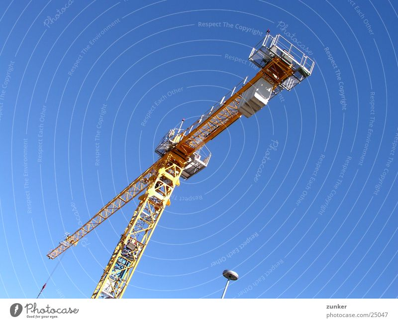 another crane Lamp Yellow Air Aviation clan Sky Beautiful weather Blue Above