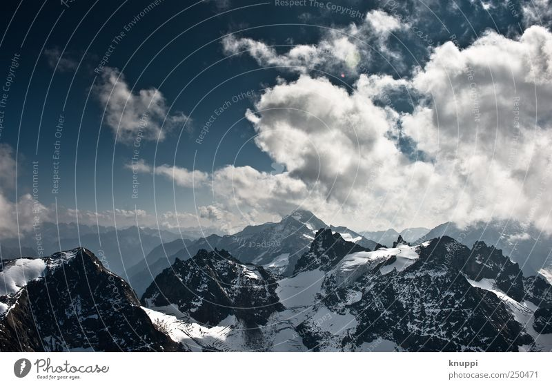 Sky Blue White Landscape Clouds Far-off places Winter Cold Mountain Environment Snow Freedom Wild Air Vantage point Trip