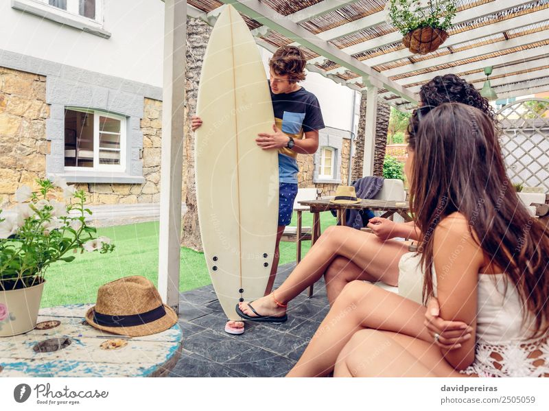 Beautiful women having fun in a surf class Woman Nature Vacation & Travel Man Summer Ocean Relaxation Joy Beach Adults Lifestyle To talk Sports Laughter Happy