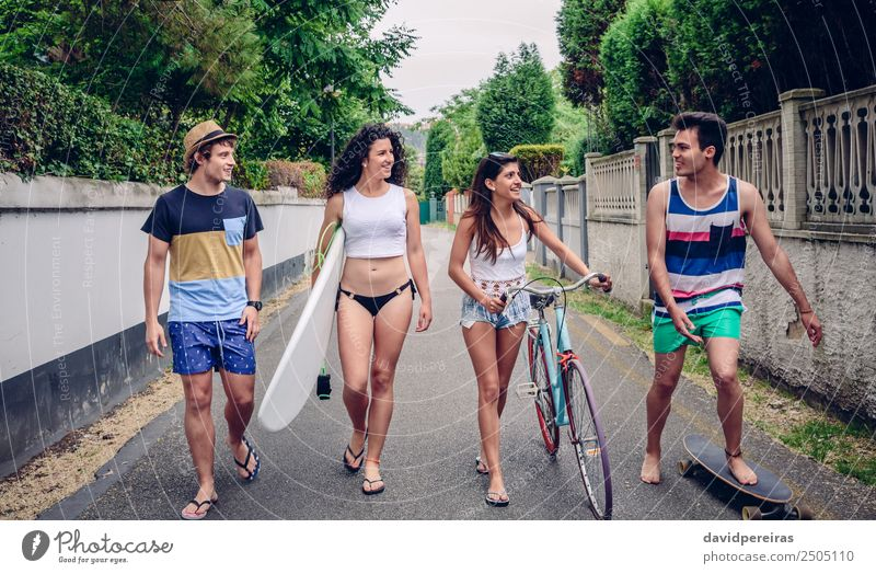 Happy young people walking along road in summer day Woman Vacation & Travel Youth (Young adults) Man Summer Relaxation Joy Street Adults Lifestyle Sports