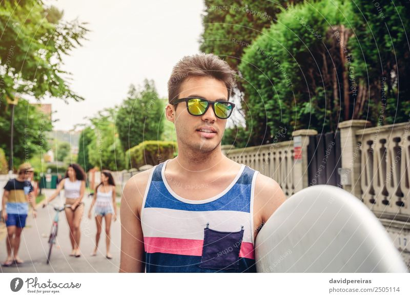 Close up of young man with sunglasses holding surfboard Woman Youth (Young adults) Man Summer Relaxation Joy Beach Street Adults Lifestyle Sports Laughter Happy