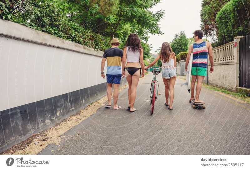Back view of young people walking along road Woman Vacation & Travel Youth (Young adults) Man Summer Joy Street Adults Lifestyle Sports Happy Group Copy Space