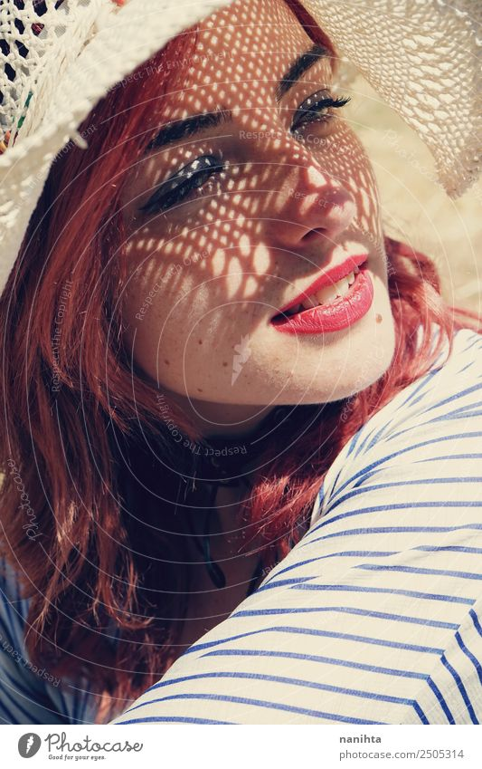 Young woman covering from sun with a hat Lifestyle Elegant Style Wellness Senses Relaxation Vacation & Travel Summer Summer vacation Sun Human being Feminine