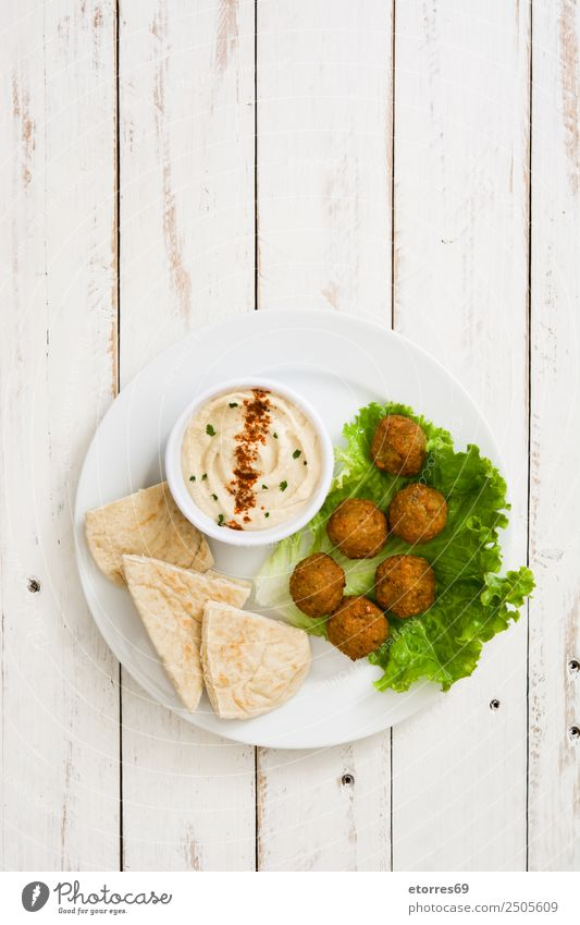 Falafel and vegetables in bowl on white wood Food Healthy Eating Food photograph Vegetable Grain Asian Food Bowl Fresh Brown falafel Chickpeas Tomato Lettuce