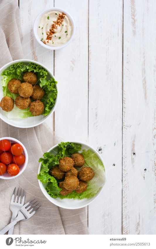 Falafel and vegetables on white wooden background. Top view Food Healthy Eating Food photograph Vegetable Grain Asian Food Bowl Fresh Brown falafel Chickpeas