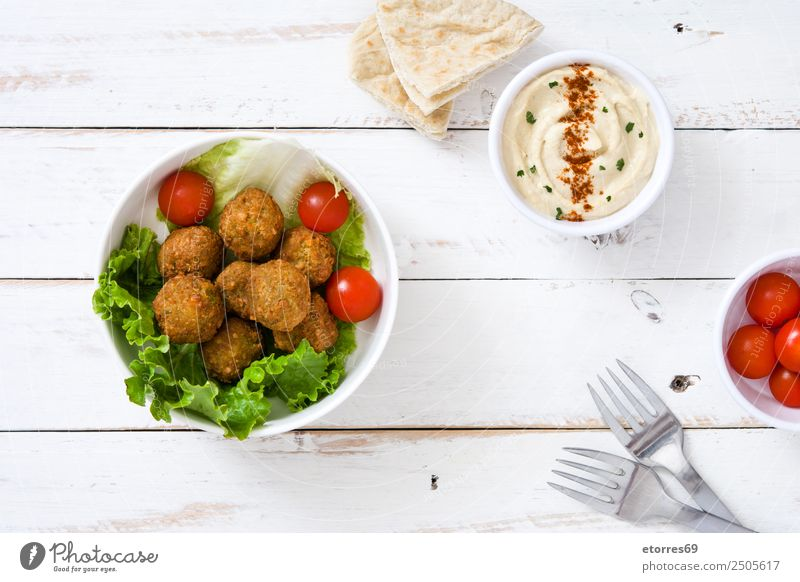 Falafel and vegetables on white wooden background. Food Healthy Eating Dish Food photograph Vegetable Grain Asian Food Bowl Fresh Brown falafel Chickpeas Tomato