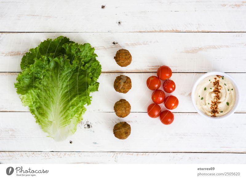 Vegetarian falafels and ingredients Food Vegetable Grain Nutrition Organic produce Vegetarian diet Asian Food Good Brown Green Red Chickpeas Tomato