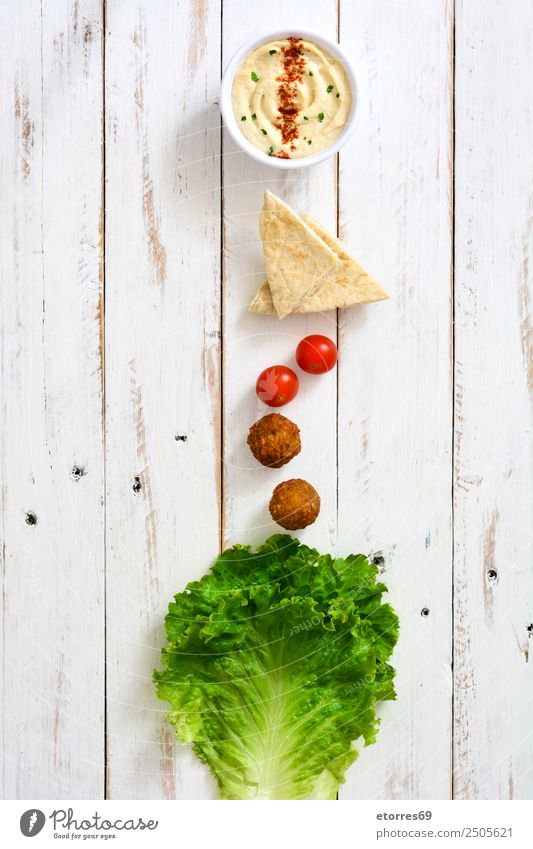 Falafel and vegetables in bowl on white wooden Food Healthy Eating Food photograph Vegetable Grain Asian Food Bowl Fresh Brown falafel Chickpeas Tomato Lettuce