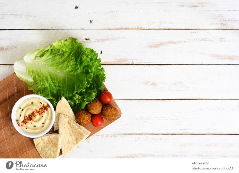 Falafel and vegetables on white wood Food Healthy Eating Dish Food photograph Vegetable Grain Asian Food Bowl Fresh Brown falafel Chickpeas Tomato Lettuce